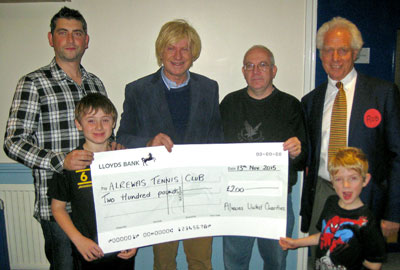 Michael and Dr Robert Horton awarding a cheque to members of the Alrewas Tennis Club
